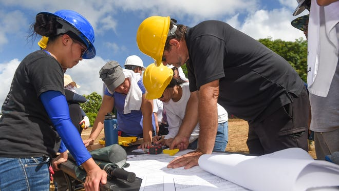 Future homeowners learn from professionals during their own home development, as part of the United States Department of Agriculture's Self-Help Housing Program at the Sagan Bonita subdivision of Mangilao on July 1, 2017.