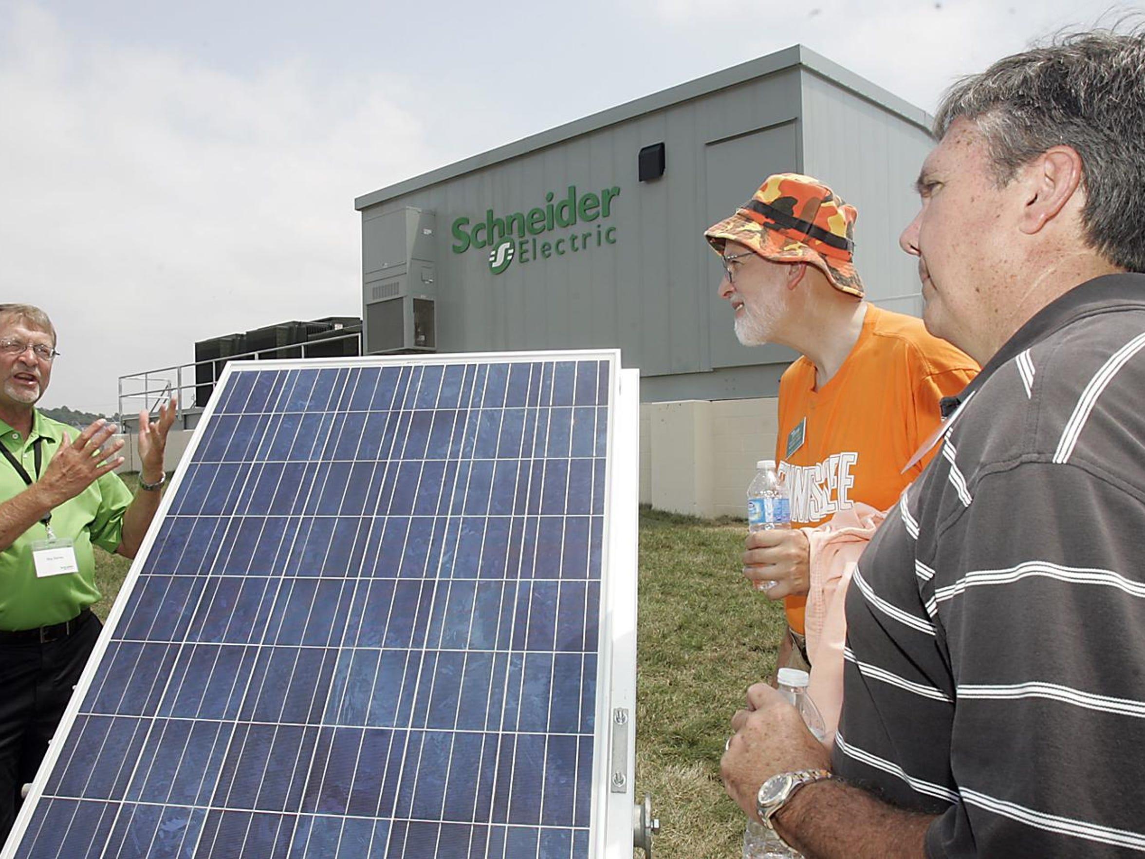 Roy Barnes, left, of Schneider Electric talks in 2011