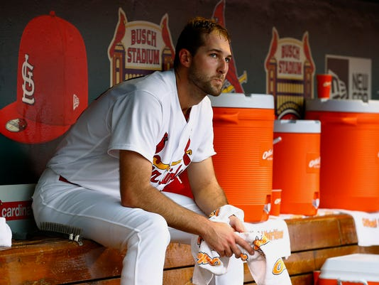 St. Louis Cardinals starting pitcher Michael Wacha reacts in the dugout after allowing six runs during the first inning of a baseball game against the Chicago Cubs, Tuesday, May 24, 2016, in St. Louis. (AP Photo/Billy Hurst)