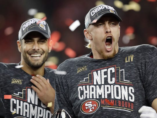 49ers quarterback Jimmy Garoppolo, left, and tight end George Kittle celebrate after winning the NFC championship over Green Bay.