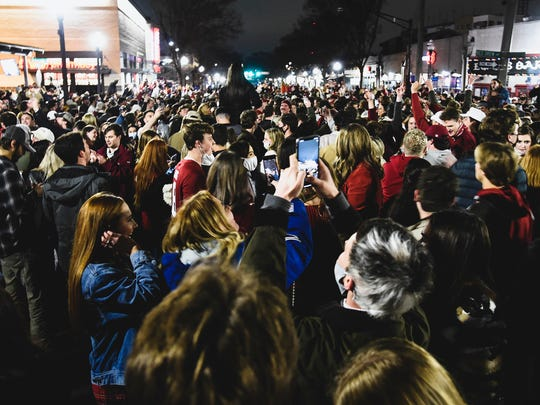 Alabama fans celebrate in the street in Tuscaloosa on Monday night after Alabama defeated Ohio State 52-24 in the NCAA college football national championship game in Miami Gardens, Fla. Many of the fans didn't take basic precautions against the coronavirus like wearing face masks.