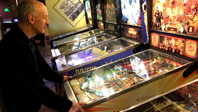Chris Tabaka, 48, of Jackson is the No. 1-ranked pinball player in Michigan, at the moment. Tabaka, who says he's a semi-retired veterinarian, started playing in earnest in college.  Here he plays in a Lansing bar on Jan. 28, 2016. He is part of a league there.