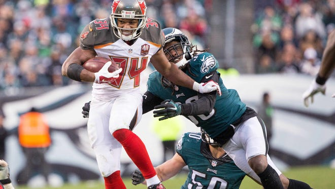 Nov 22, 2015; Philadelphia, PA, USA; Tampa Bay Buccaneers running back Charles Sims (34) breaks the tackle of Philadelphia Eagles defensive back E.J. Biggers (38) during the second half at Lincoln Financial Field. The Buccaneers won 45-17. Mandatory Credit: Bill Streicher-USA TODAY Sports