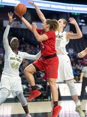 Wake Forest's Lindsey Jarosinski (50) joins her teammate, Ona Udoh (44), in defending Louisville guard Mykasa Robinson (5) in Winston-Salem, N.C., Sunday, Jan. 20, 2019. Jarosinski, a 6-foot-5 freshman forward, announced Monday that she will transfer to Iowa State.