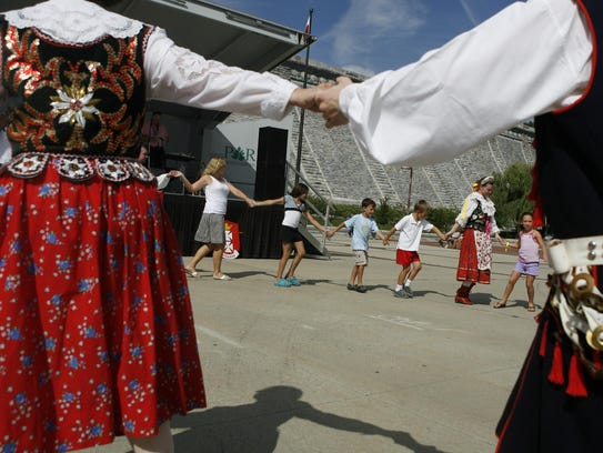 Children dance with Poloanise Folk Dancers during the