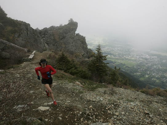 Ultramarathoner Scott Jurek runs near the summit of