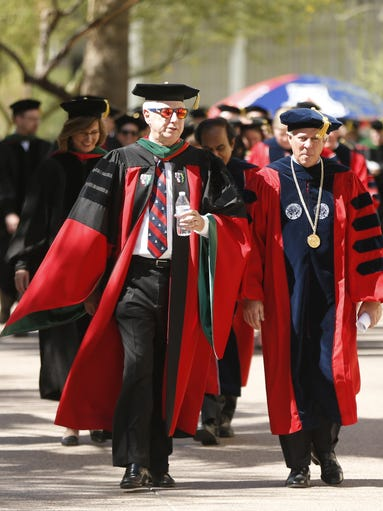 Dean Guy Reed leads soon-to-be graduates as they march