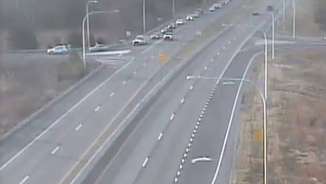 A DelDOT traffic camera shows northbound traffic getting off at Trap Shooters Rd.  A crash at Barkers Landing Bridge in Kent County has the northbound lanes closed.