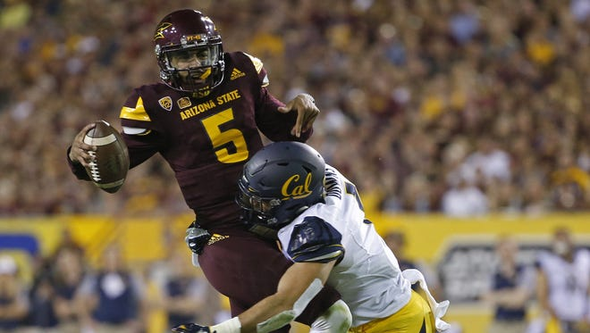 California's Devante Downs (1) tackles ASU's Manny Wilkins (5) for a loss during the first half at Sun Devil Stadium on September 24, 2016 in Tempe.