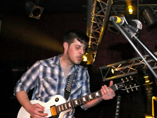 Adam Gingrich, lead guitarist of Carving Out Fiction