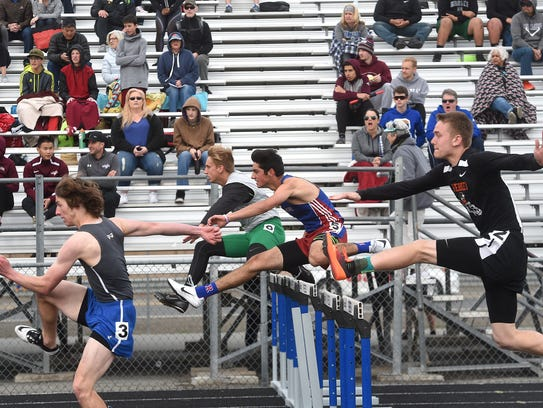 Varsity boys compete in the 110 meter hurdles during