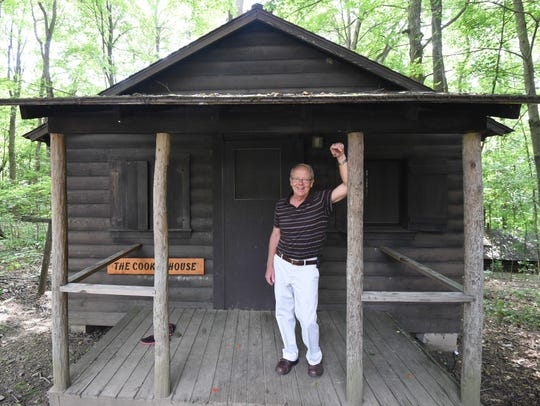 Terry Conard, director of Friendly House, stands on