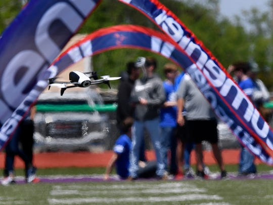 A student from Christoval ISD pilots a Parrott Bebop drone through the first set of gates during the Blackland Drone Races at Roscoe Collegiate High School on Friday. Three schools competed in a variety of events using drones of varying sizes.