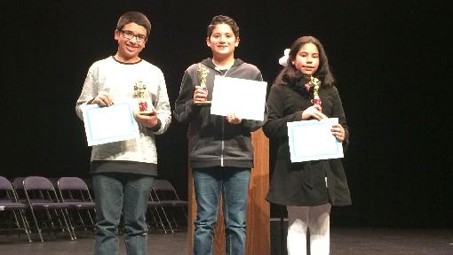 From left, Jesus Martinez  and Adrian Gomez Ferraez, both sixth-grade students at Hermosa Middle School, and Bluffview Elementary School fifth-grade student Ximena Ortiz pose for a photo after the Farmington Municipal School's District Spanish Spelling Bee on Feb. 2 at Piedra Vista High School. Ortiz won the spelling bee. Gomez Ferraez finished in second place, and Martinez was third.