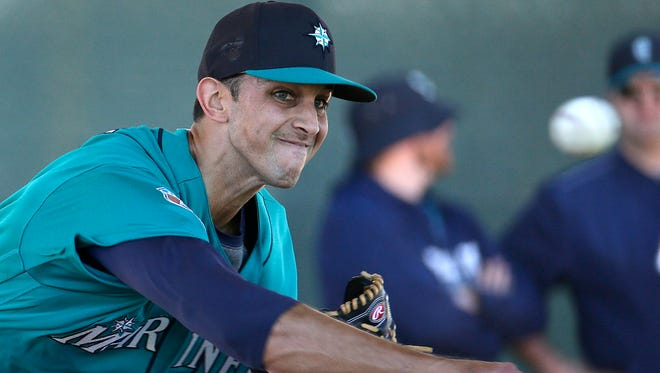 Seattle Mariners pitcher Steve Cishek throws during spring training baseball practice, in Peoria, Ariz. There may not be a more important offseason signing for the Seattle Mariners than relief pitcher Steve Cishek. (AP Photo/Charlie Riedel, File)