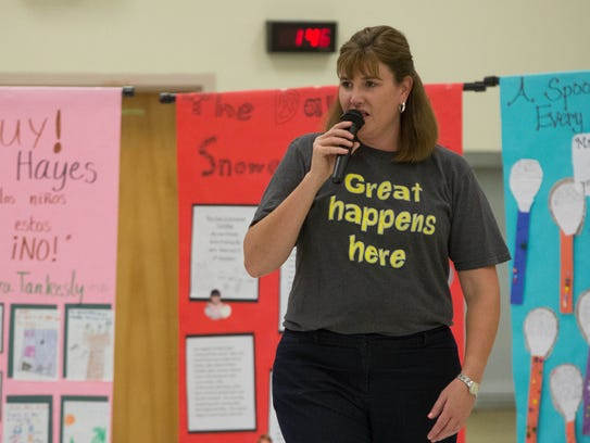 Kelly Mahres, the principal of University Hills Elementary School, talks to her students about the summer reading challenge they participated in, before announcing the winners of that challenge. Wednesday October 18, 2017.