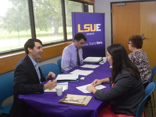 ANI Adjunct Job Fair Patton Griffith (left, front), director of continuing education at LSUE, talks with attorney Meagan Miller (front, right) at the adjunct faculty job fair held Tuesday, June 30, 2015 at the Learning Center for Rapides Parish located on