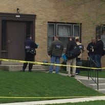 Investigators respond to the scene of an apparent fatal shooting Sunday in West Allis.