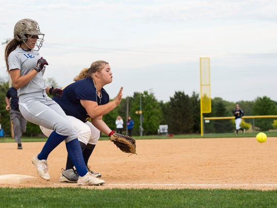 Greencastle-Antrim first baseman Alicen Hoover takes a throw from right field hoping to catch a Lower Dauphin player during the Mid Penn softball semifinals on Tuesday, won by the Falcons, 4-1.