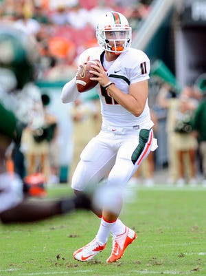 Ryan Williams looks to pass while playing quarterback at Miami.
