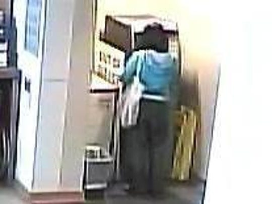A woman suspected of using a stolen debit card at an ATM inside Ministry Saint Michael's Hospital is seen on security footage.