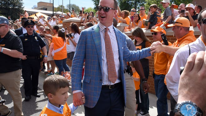 Peyton Manning and son Marshall join the Vol Walk on Saturday, Sept. 30, 2017 before the Tennessee vs. Georgia game.