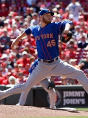 New York Mets starting pitcher Zach Wheeler (45) throws against the Cincinnati Reds in the fourth inning at Great American Ball Park.