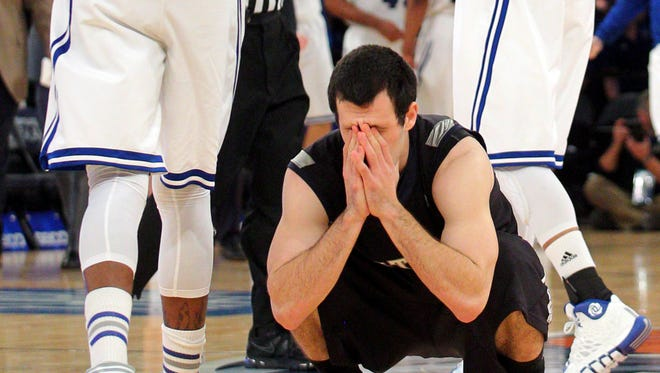 Mar 12, 2014; New York, NY, USA; Butler Bulldogs guard Alex Barlow (3) reacts after missing a shot at the final buzzer of the game against the Seton Hall Pirates during the second half in the first round of the Big East tournament at Madison Square Garden.