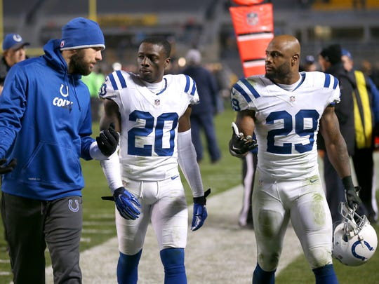 Indianapolis Colts quarterback Andrew Luck (12), left, walks off the field with teammates cornerback Darius Butler (20) and strong safety Mike Adams (29) after the team's loss of an NFL football game Sunday, Dec. 6, 2015, at Heinz Field, in Pittsburg, Pa. The Steelers won 45-10.