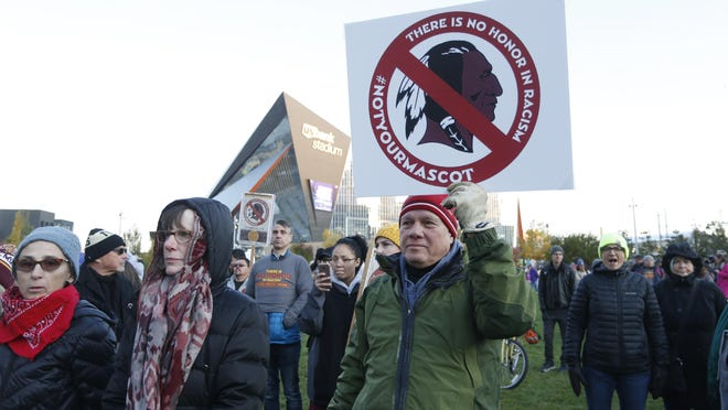 FILE - In this Oct. 24, 2019, file photo, Native American leaders protest against the Redskins team name outside U.S. Bank Stadium before an NFL football game between the Minnesota Vikings and the Washington Redskins in Minneapolis. Several Native American leaders and organizations have sent a letter to NFL Commissioner Roger Goodell calling for the league to force Washington Redskins owner Dan Snyder to change the team name immediately.