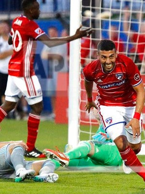 FC Dallas midfielder Javier Morales (11) celebrates the first goal of the evening during the first half of an MLS soccer match against Minnesota United at Toyota Stadium in Frisco, Texas on Saturday, April 8, 2017.