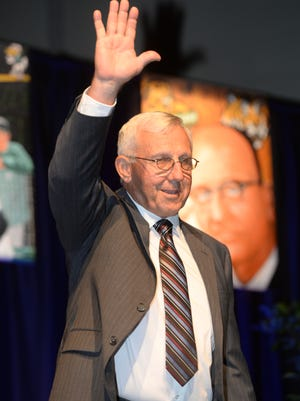 Jim Hightower waves as he walks up on stage during his induction into the 2016 Louisiana Sports Hall of Fame on Saturday at the Natchitoches Events Center.