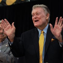 Iowa Governor Terry Branstad thanks Hayden Fry at FRYfest at the Coralville Marriott on Friday, Sept. 4, 2015. Fry received a proclamation from Governor Branstad for his work with the America Needs Famers initiative, which began 30 years ago.
