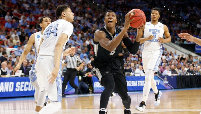 Mar 19, 2016; Raleigh, NC, USA; Providence Friars guard Kris Dunn (3) prepares to shoot the ball in front of North Carolina Tar Heels forward Justin Jackson (44) and guard Marcus Paige (5) in the second half during the second round of the 2016 NCAA Tournament at PNC Arena.
