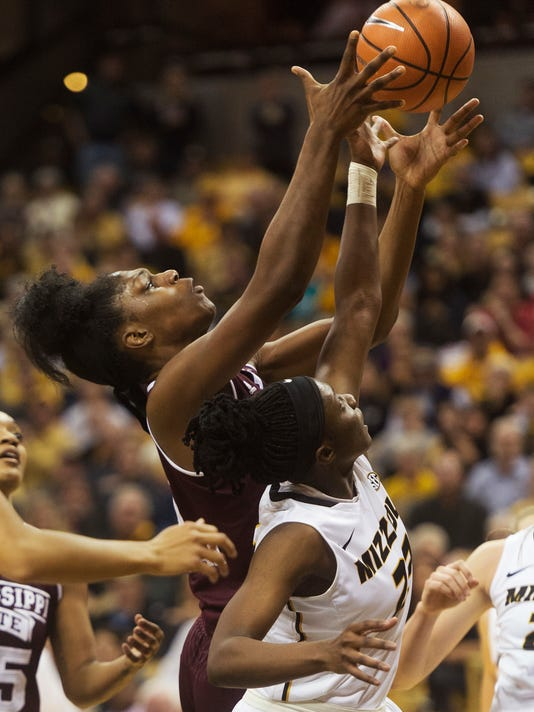 Mississippi State's Teaira McCowan, left, pulls down a rebound over Missouri's Amber Smith, right, during the second half of an NCAA college basketball game Thursday, Feb. 1, 2018, in Columbia, Mo. Mississippi State won the game 57-53. (AP Photo/L.G. Patterson)
