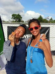 Over 100 athletes participated in the Guam Volleyball Federation's Junior Cup and Kids Cup held at the Guam Football Association's sand courts on Apr. 9 and 10. Pictured are third-place finishers Ivory Howat, left, and Monica Giger. Giger will be attending St. John's on a sports scholarship in 2016-2017.