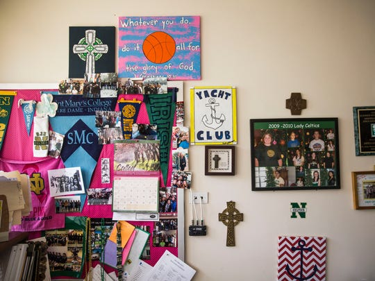 The wall next to teacher Shelley Raley's desk in her classroom is covered with photos, posters and other items at St. John Neumann Catholic High School on Wednesday, May 2, 2018.