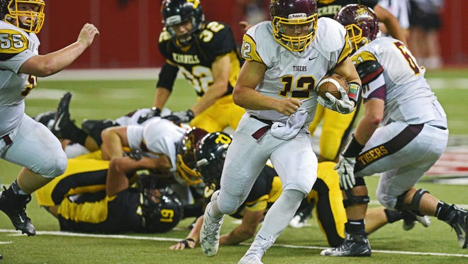 Harrisburg's Hunter Headlee (12) carries the ball during the 2016 South Dakota State Class 11AA Football Championship game against Mitchell Friday, Nov. 11, 2016, at the DakotaDome on the University of South Dakota campus in Vermillion, S.D. Mitchell beat Harrisburg 41-6.