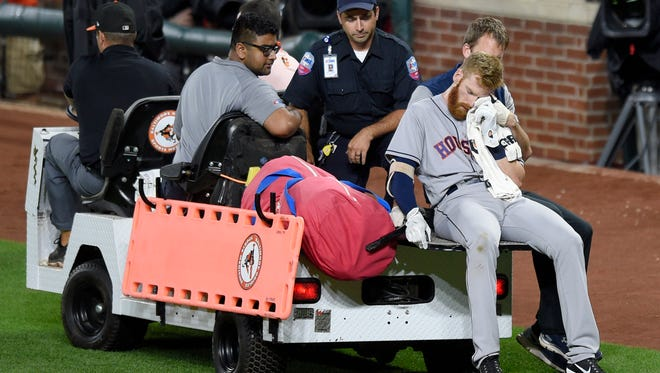 Houston Astros' Colin Moran, a Rye native and Iona Prep graduate, holds a towel as he is carted off the field after he sustained an injury to his face during his at bat in the sixth inning of a baseball game against the Baltimore Orioles, Saturday, July 22, 2017, in Baltimore.