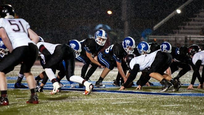 Heavy rains fall early in the match-up between Harper Creek and Marshall Friday night.