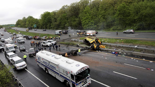 The overturned Paramus school bus on Route 80 in Mount Olive on May 17, 2018, with a Morris County emergency management vehicle in the foreground.
