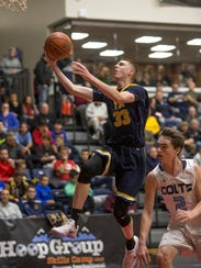 Toms River North's Travis Holland goes up for a layup during the 2016-2017 season. FILE PHOTO