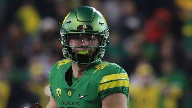Oregon Ducks quarterback Justin Herbert (10) runs the ball against the Oregon State Beavers in the 2017 Civil War.