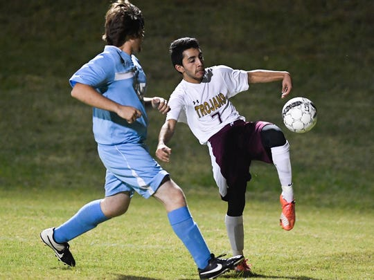 Webster County's Josue Martinez (right) and Union County's Hunter Nalley try to control the ball as Union County plays Webster County in the Boys District Soccer Tournament in Morganfield Monday, October 10, 2016.