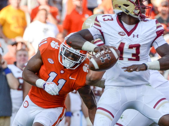 Clemson safety Isaiah Simmons (11) pressures Boston College quarterback Anthony Brown (13) during the fourth quarter in Memorial Stadium at Clemson on Saturday.
