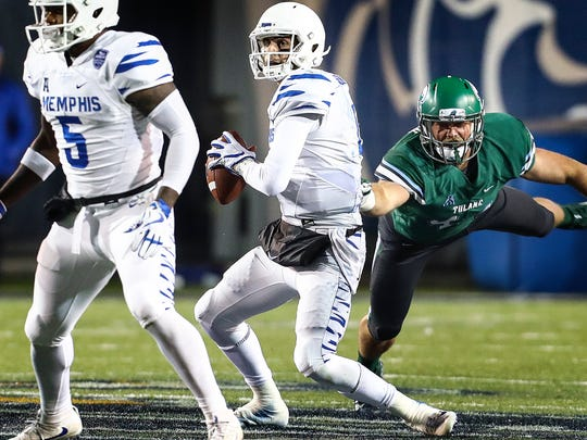 University of Memphis quarterback Riley Ferguson (middle) breaks away from the Tulane University defense during second quarter action in Memphis, Tenn., Friday, October 27, 2017.