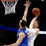 Syracuse's Tyler Lydon, an Elizaville native, goes up for a dunk against Middle Tennessee's Reggie Upshaw on Sunday at Scottrade Center in St Louis, Missouri.