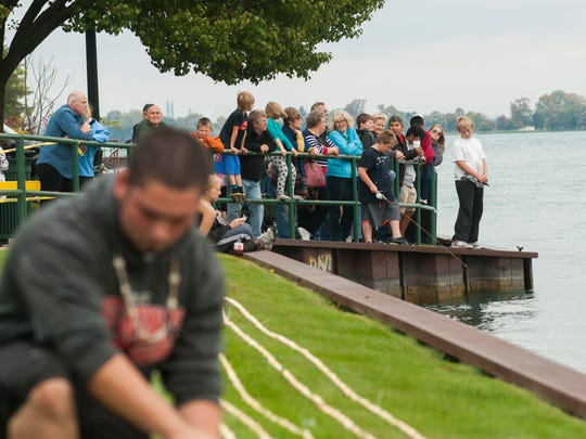 People come out to watch the record setting event Sunday, Oct. 17, in Marine City. Residents broke the record for longest string of popcorn with 1200 feet.