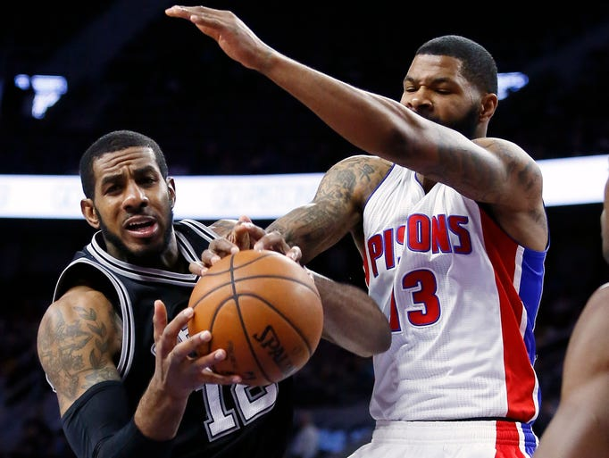 San Antonio Spurs' LaMarcus Aldridge, left, grabs a