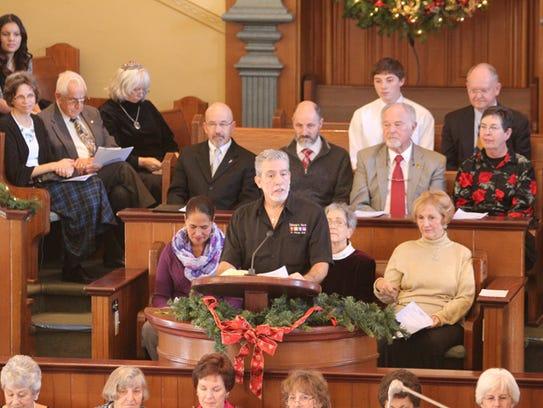 Pastor Jimi Kestin welcomes the public to the Prayer